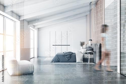 Fotomural  Woman walking in attic bedroom with armchair