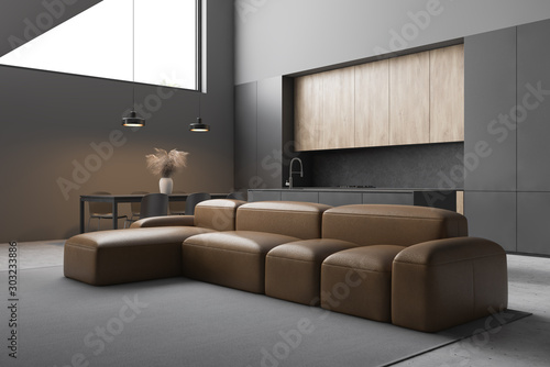 Obraz Leather sofa in modern living room and kitchen - fototapety do salonu