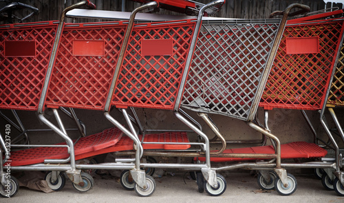 aged and worn vintage shopping carts #303237430