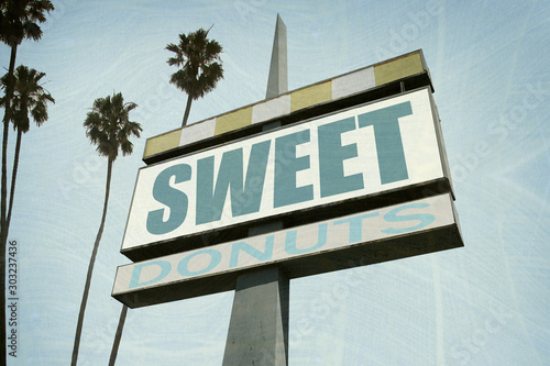 aged and worn sweet donuts sign #303237436