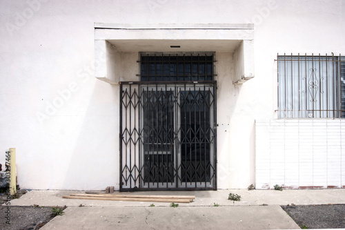 old dilapidated urban building with security fence #303237464