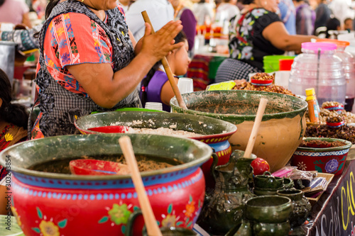 Obraz Mexican woman cooking a traditional dish - fototapety do salonu