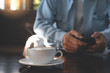 Man using mobile phone and coffee