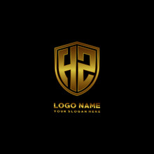 Initial Letters HZ Shield Shape Gold Monogram Logo. Shield Secure Safe Logo Design Inspiration