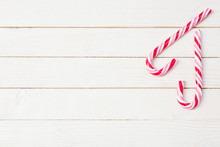 Candy Cane On White Wooden Bac...