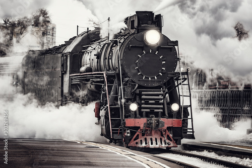Garden Poster Retro Steam train departs from Riga railway station. Moscow. Russia.