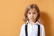 Sad Little Girl On Color Background
