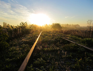 Abandoned railway at dawn of a sunny day