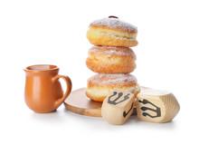 Tasty Donuts For Hanukkah And Dreidels On White Background