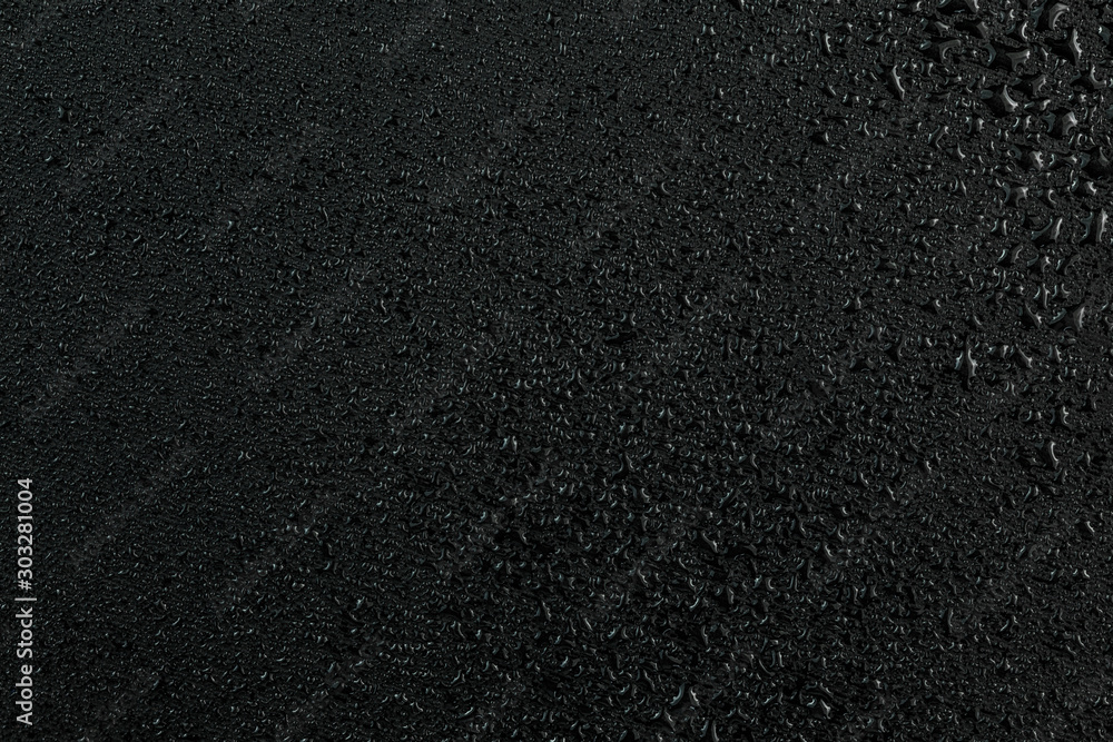 Fototapety, obrazy: A dark abstract background of water drops on flat black rubber surface