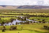 Fototapeta Sawanna - Oblique aerial view of  floodplains and marshes near Wyndham in Cambridge Gulf in the Kimberley region of Western Australia.