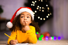 Pensive Little Black Girl Thinking What To Ask From Santa Claus