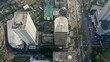 Overhead view of building rooftops in the Sudirman Central Business District, Jakarta Indonesia daytime, Upward motion