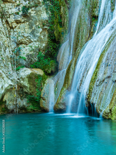 Waterfall green forest river stream - 303288058