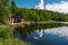 Typical Norvegian House In The Border Of The Lake Lille Trollvatnet.  Nordland, Norway.