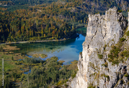 View from up to autumn Alps mountain lake with clear transparent water and reflections Canvas Print