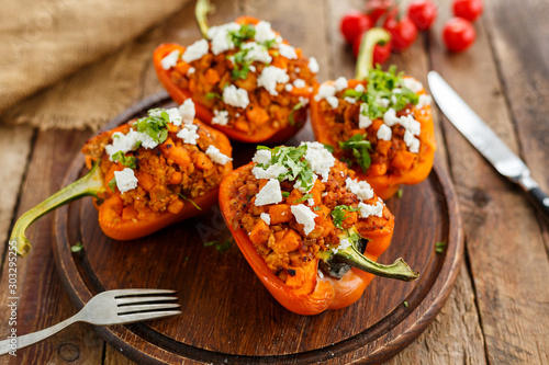 stuffed peppers with meat - 303295255