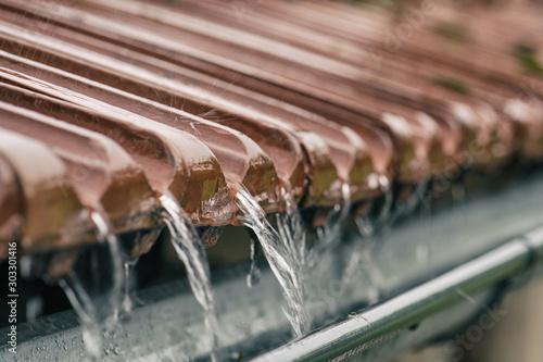 Obraz na plátně Soft focus storm rain on the roof of the house.