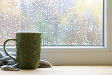 Green Mug And Soft Blanket By The Window.