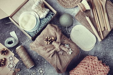 Zero waste christmas gifts . Eco friendly products laid out on table. Burlap packaging. Top view.