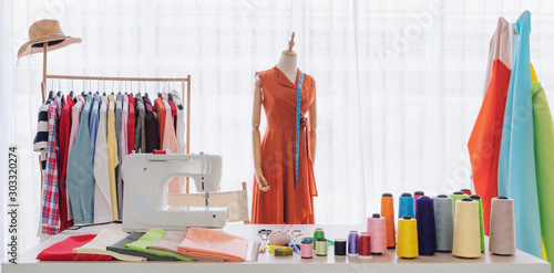 Fashion designer working studio, with sewing items and materials on working tabl Wallpaper Mural