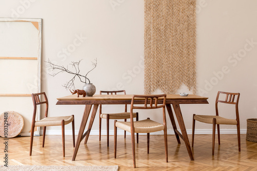 Fototapeta Stylish and beige interior of dining room with design wooden table and chairs, vase with flowers, sculpture, elegant and rattan accessories. Korean style of home decor.  Wooden parquet. Template. obraz