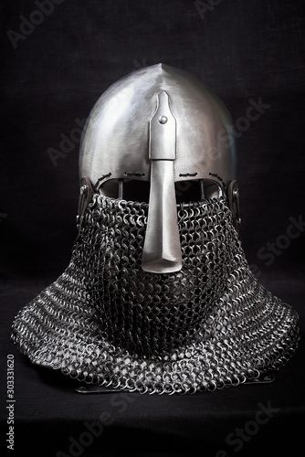 Knight helmet on a black background. Front view. Canvas Print