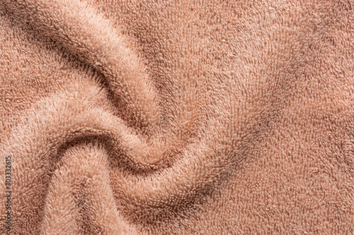 Photo  Texture of soft terry fabric in beige, swirl