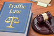 canvas print picture - A law book with a gavel  - Traffic law