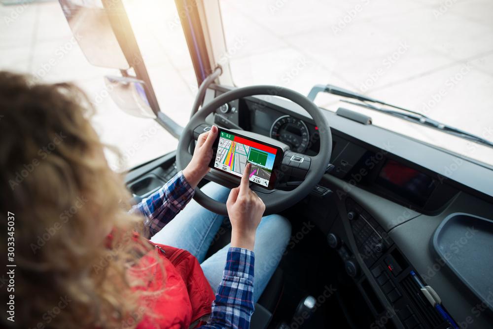 Fototapeta Shot of an unrecognizable truck driver using global positioning system GPS navigation for destination. Fingers choosing route navigation. Transportation services.