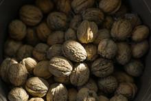 A Pile Of Walnuts. Full Bucket...