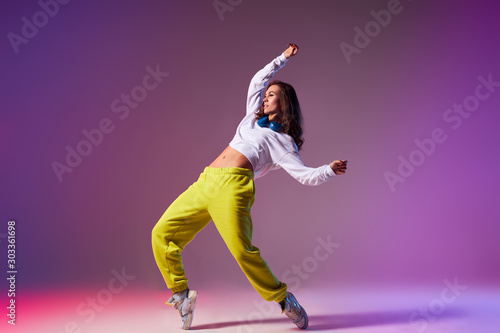 Pretty bright professional dancer performing house dance isolated on light colou Fotobehang