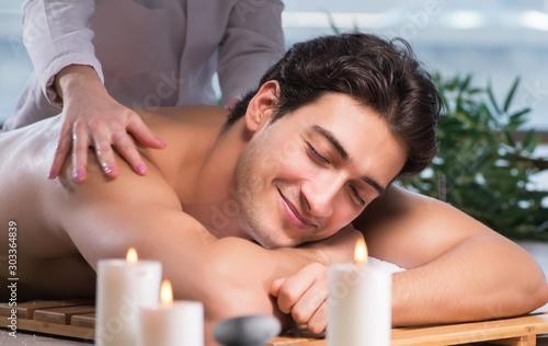 Cuadros en Lienzo  Young handsome man during spa procedure