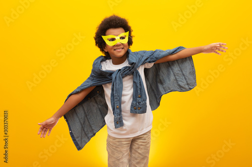 Foto  Portrait of a young, mixed race boy dressed as a superhero