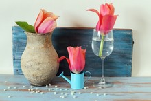 Decorative Composition Of Fresh Pink Tulips On A Wooden Background