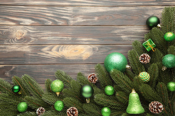 Christmas tree branches with green christmas decoration on a white background