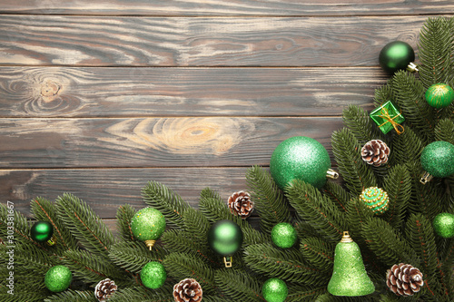 Obraz Christmas tree branches with green christmas decoration on a white background - fototapety do salonu