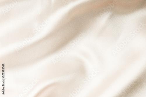 фотография  beige silk fabric texture. Satin Background