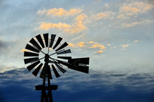 Rural Windmill And Clouds At D...