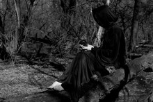 Hooded Woman With Dark Long Ha...