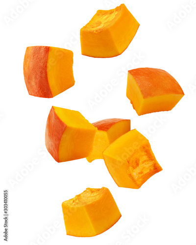 Falling piece of pumpkin, cubes, isolated on white background, clipping path, fu Fototapeta