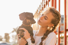 Teenager Girl Holding Her Dach...