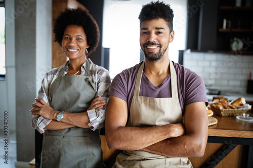 Portrait of happy chefs in kitchen. Healthy food, cooking, people, kitchen concept