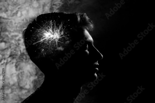 Fotomural  the young man remains calm, emotions are raging inside, a symbolic image, double