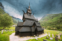 Borgund, Norway. Famous Landmark Stavkirke An Old Wooden Triple Nave Stave Church In Summer Day. Ancient Old Wooden Worship In Norwegian Countryside Landscape