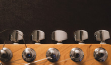 Electric Guitar Head And Tuning Pegs Detail