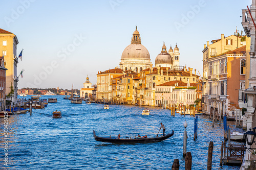 Foto  Gondola in sunny day in Venice, Italy