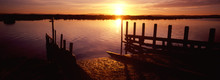 Sunrise Over River And Jetty.