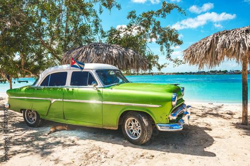 Playa La Herradura, Cuba - October 27, 2019: American classic car on the beach P Canvas Print