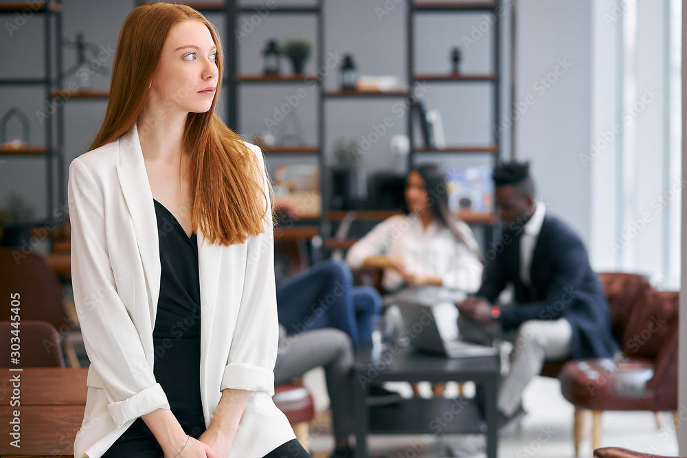 Fototapety, obrazy: Young caucasian redhaired businesswoman dressed in white blazer stand dreaming looking side